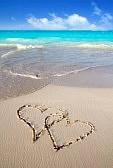 9941676-hearts-in-love-written-in-caribbean-tropical-beach-sand